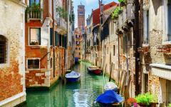 Boats on a Venetian canal, Italy.