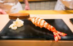 Shrimp sushi served at Sukiyabashi Jiro, Jiro Ono's michelin-starred sushi restaurant. Photo by City Foodsters on Flickr.