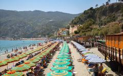 Parasols on a beach in Monterosso al Mare, Liguria, Italy.