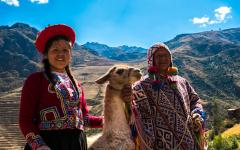 Quechuan people with a llama in the Sacred Valley.