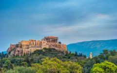The Parthenon and Herodium temples sitting atop Acropolis Hill at dusk | Athens, Greece