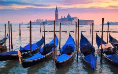 blue gondolas on water in venice