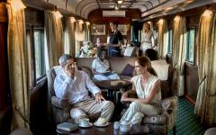 Men and women enjoying the luxurious Rovos Rail train-hotel in South Africa