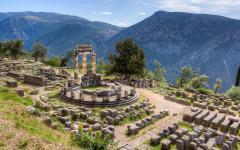 The stone ruins of the Sanctuary of Athena Pronaia in Delphi Greece