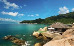 Guests swimming by their bungalow at Six Senses Ninh Van Bay. Photo: Basil Childers/Courtesy Six Senses Ninh Van Bay