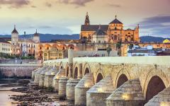 spain cordoba view of the roman bridge and cathedral over the guadalquivir river