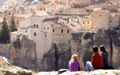 three women look out on the landscape of cuenca