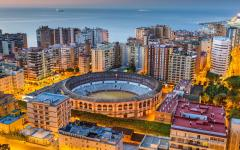 spain malaga city lit up at dawn with the bullring in the center