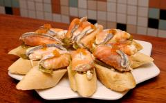 spain san sebastian a plate of bread and seafood