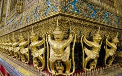 corner detail of a golden artefact in the grand palace