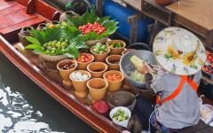 Woman sells papaya salad at the floating market.