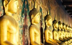 Golden Buddha statues in Wat Arun in Bangkok, Thailand.