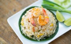 rice with prawns on a white plate