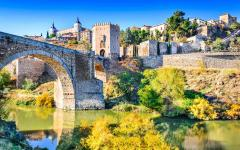 spain toledo beautiful old alcantara bridge and buildings across the tagus river