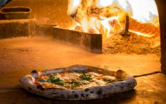 Traditional pizza baked in a wood fired oven.