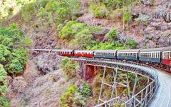 a train passes over the barron gorge on the kuranda scenic railway