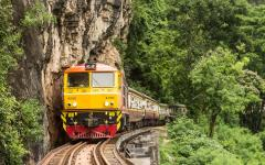 train passing wooden bridge on death railway