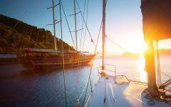 Sail boats at sunset.
