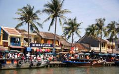 Boats in the harbor along the shore of Hoi An.