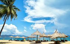 Lounge chairs on beach in Nha Trang.