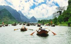 Boats cruising along Ha Long Bay.