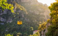 spain catalonia yellow cable car through the montserrat peaks