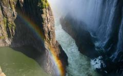 Incredible aerial view of Victoria Falls with a rainbow forming through the mist | Zambia, Africa