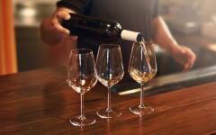 Sommelier fills glasses during a tasting.