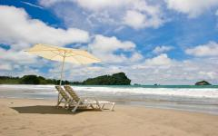 Lounge chairs on the beach in Costa Rica.