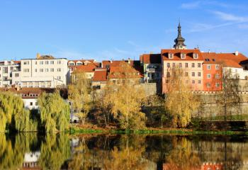 A view of a traditional Czech town on a river.