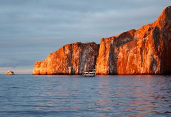 Kicker Rock at sunset near the Galapagos Islands.