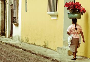 A woman walks the colonial streets of Antigua, Guatemala.
