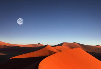A moon over the Namib Desert in Namibia.