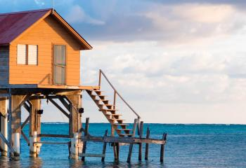 A tropical house on a beach in Abergris Caye, Belize.