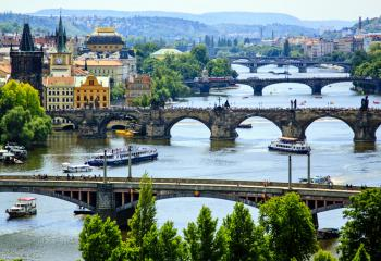 Bridges cross the Charles River in Prague, Czech Republic.