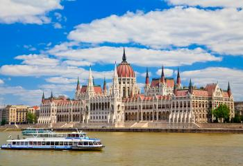 A boat passes in front of Parliament in Budapest, Hungary.