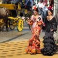 Women wearing traditional dresses in Seville, Spain.