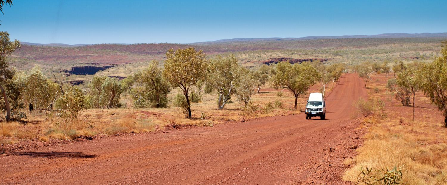 A car rides through the Outback.