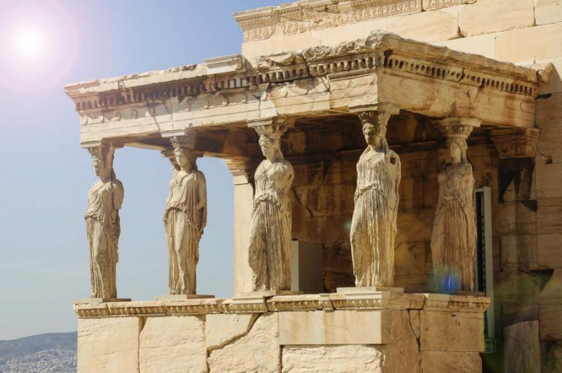 Figures of the Caryatid Porch of the Erechtheion on the Acropolis. Athens, Greece. Credit: Shutterstock.