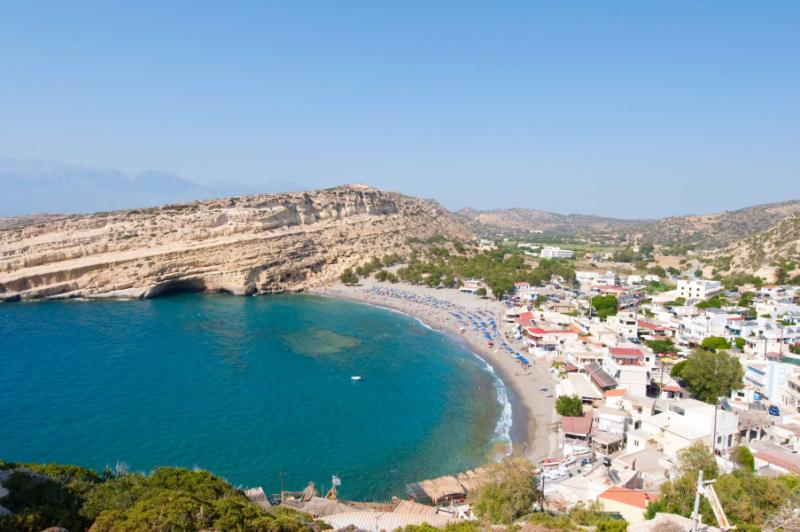 Matala Sandy Beach with Caves Near Heraklion on the Island of Crete, Greece. Credit: Shutterstock.
