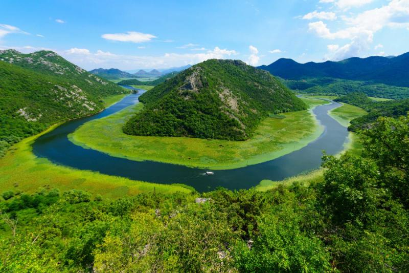 The green pyramid at Rijeka Crnojevica River at Skadar Lake National Park.