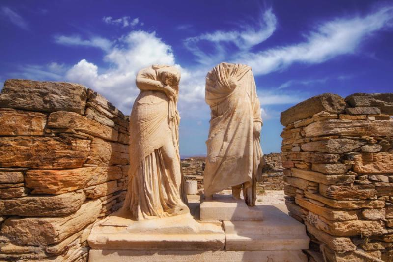 Sculptures of Cleopatra and Dioskourides in the House of Cleopatra. Delos Island, Greece. Credit: Shutterstock.