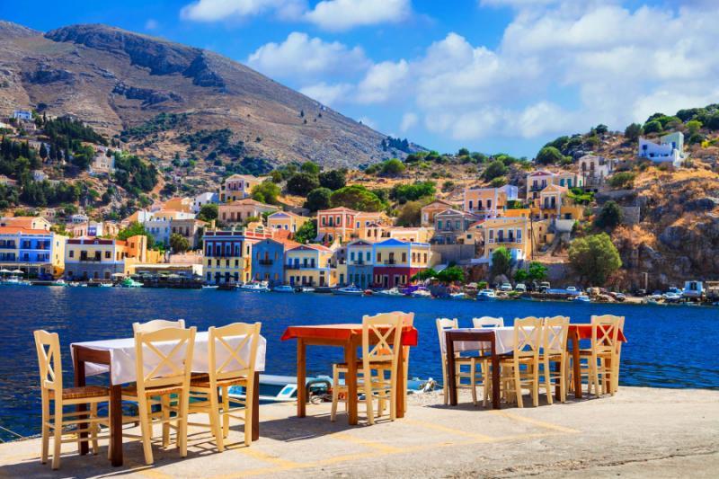 Small Street Tarvernas in Symi Island, Greece. Credit: Shutterstock