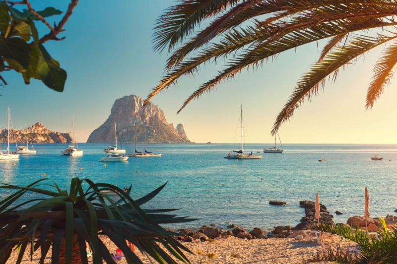 Epicurean spain madrid salamanca toledo ibiza barcelona spain ibiza beautiful view of boats on the water and beach at sunset publicscrutiny Image collections