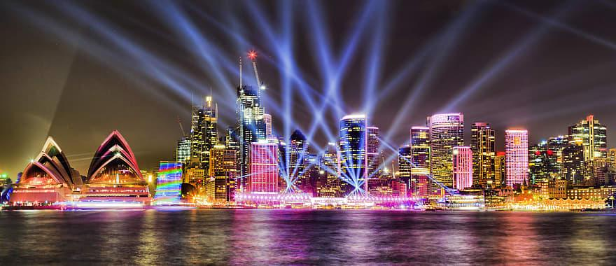Night light shine on harbor in Sydney Australia.