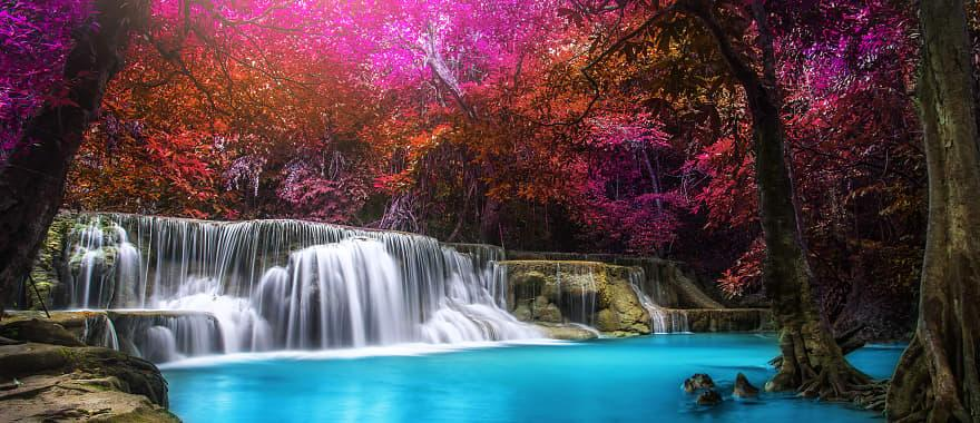 Vibrant Huay Mae Kamin Waterfall in rainforest at Kanchanaburi province, Thailand