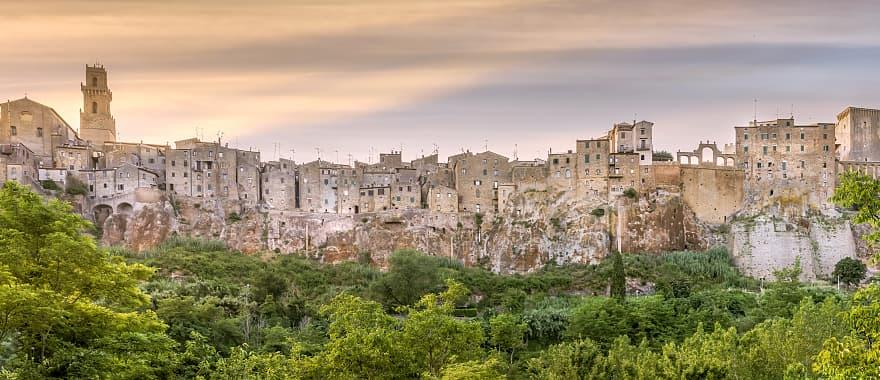View of Pitigliano town at sunset. Picturesque and unusual - built on tuff, tufaceous volcanic rock.