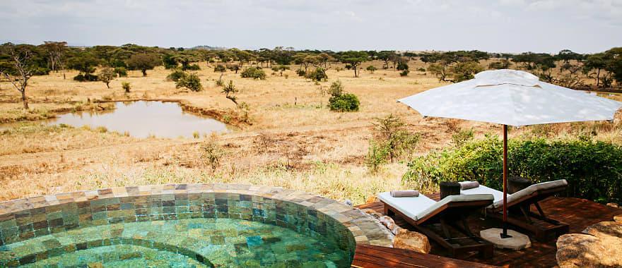 Africa-Swimming-pool-Safari-lodge-terrace-in-Savanna-forest-Serengeti-Grumeti-Reserve-Tanzania