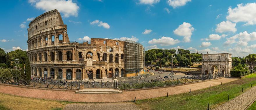 The Roman Colosseum at midday surrounded by tourists | Italy