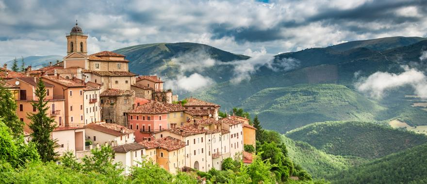 The small Italian Town of Umbria sitting on green rolling hills